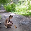Stock Photo: Girl feed funny little squirrel