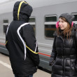 Young couple on railway station platform — Stock Photo