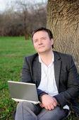 Podnikatel s notebookem — Stock fotografie