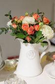 White ceramic jug full of flowers — Stockfoto