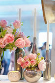 Beautiful pink flowers and candles decoration — Stock Photo
