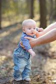 Stylish baby boy outdoors — Stock Photo