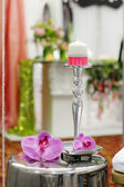 Candle and purple orchid as decorations — Stock Photo