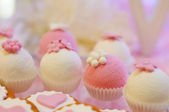 Delicious pink and white cupcakes — Stock Photo