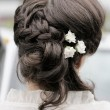 Beauty wedding hairstyle with flowers — Stock Photo