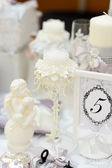 Elegant white candle and other wedding objects — Stock Photo