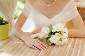 Bride hands with wedding ring — Stock Photo