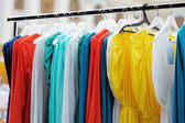 A few beautiful dresses on a hanger — Stock Photo