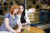 Two young girls taking selfie — Stock Photo