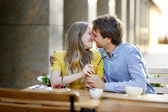 Young couple in the outdoor cafe — Stock Photo