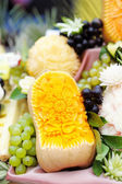 Fruits table with carved pumpkin — Foto Stock