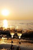 Romantic beach evening on the sunset  — Stock Photo