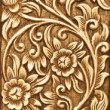 Flower carved on wood — Stock Photo #12401794