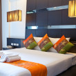 Hotel room with bed and wooden - Stockfoto