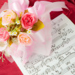 Royalty-Free Stock Photo: Rose on the musical notes