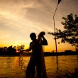 Silhouette of fishermen — Stock Photo