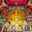 Golden Statue of Guan Yin - Stock Photo