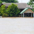 Flood waters overtake a house — Stock Photo