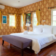 Hotel room with bed and wooden — Stock Photo
