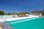 Swimming pool besides mountains — Stock Photo