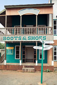 Boots house in Wild West style — Stock Photo