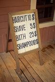 Haircut wooden billboard — Stock Photo
