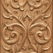 Flower carved on wood - Stock Photo