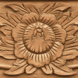 Flower carved on wood — Stock Photo #21853713