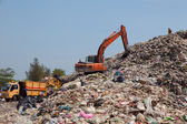 Backhoe at garbage dump — Stock Photo