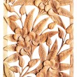 Stock Photo: Flower carved on wood