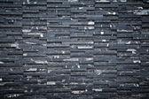 Muro di mattoni nero — Foto Stock