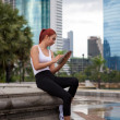 Fitness woman using tablet — Stock Photo