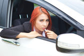Woman applying makeup while in the car — Stock Photo