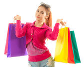 Woman holding shopping bags — ストック写真