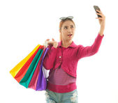Shopping woman self photographing — Stock Photo