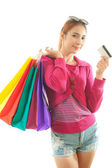 Woman holding credit card and shopping bags — Stockfoto