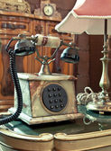 Vintage telephone on the table — Stock Photo