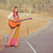 Hippie woman playing music and dancing — Stock Photo #38983399