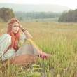 Hippie girl at golden field — Stock Photo #38985231