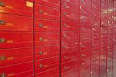 Row of red steel lockers — Stock Photo