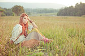 Hippie girl at golden field — Stock Photo