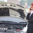 Stock Photo: Womwith car broke down