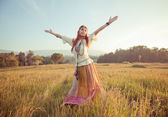 Woman with arms outstretched — Stock Photo