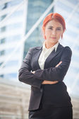 Business woman smiling arms crossed — Stok fotoğraf
