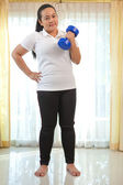 Fat woman does fitness with dumbbell — Foto de Stock