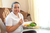 Fat woman eating salad — Stock Photo