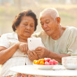 Senior couple using the tablet — Stock Photo
