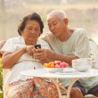 Senior couple using the mobile phone — Stock Photo #42533131