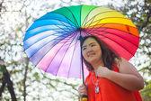 Happy fatty woman with umbrella — Stock Photo