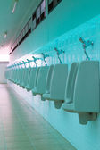 Porcelain urinals in public toilets — Foto Stock